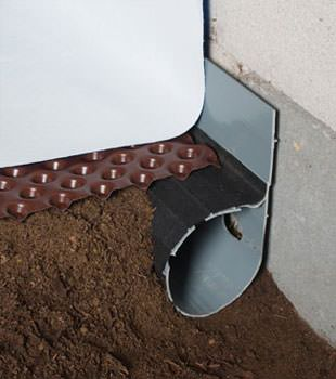 Closeup of a crawl space drainage system installed in Frankford