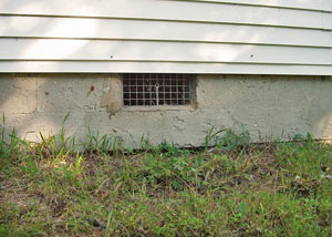 Open crawl space vents that let rodents, termites, and other pests in a home in Bruceton