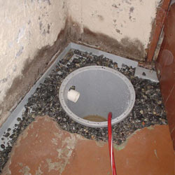 Installing a sump in a sump pump liner in a Picton home