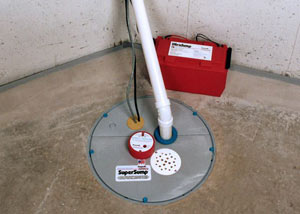 A sump pump system with a battery backup system installed in Kaladar