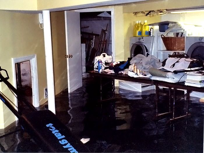 A Laundry Room Flood In Matawatchan, With Several Feet Of Water Flooded In.